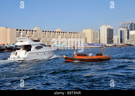 Dubai Creek waterfront with Abras water taxis and modern motor boat launch - Stock Photo