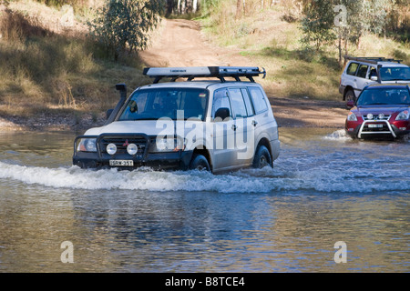 A Pajero leads the way across the Macquarie River near Dubbo in Central New South Wales - Stock Photo
