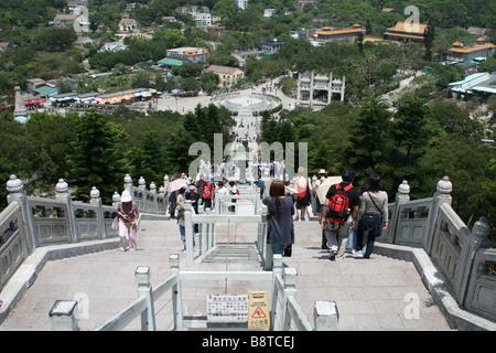 tourists on steps leading from Giant Buddha to Po Lin Monastery Lantau Island Hong Kong  April 2008 - Stock Photo