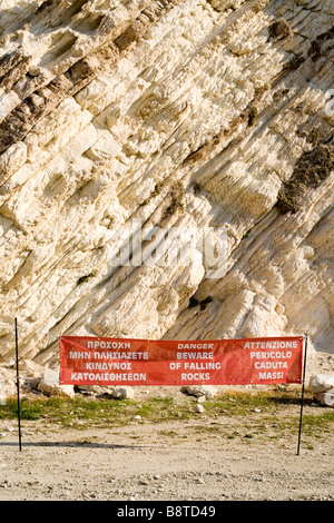 Rock strata and warning sign - Mirtos beach, Kefalonia, Greece Europe - Stock Photo