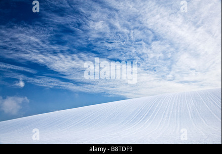 A sunny snowy winter abstract minimalist landscape view or scene on the Downs in Wiltshire England UK - Stock Photo
