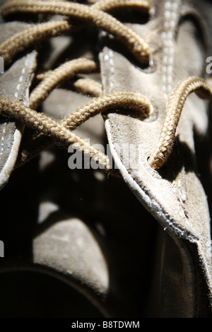 close up detail of one old man's sports shoe trainer - Stock Photo