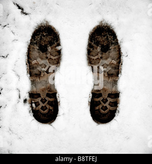 Boot foot prints in the white snow - Stock Photo