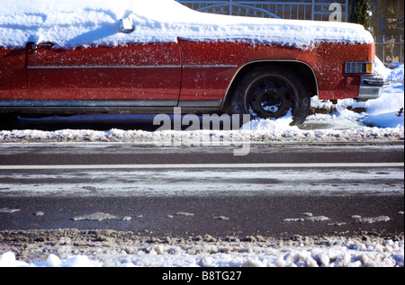 Old Cadillac Buried in Snow on a Cold WInter Day - Stock Photo