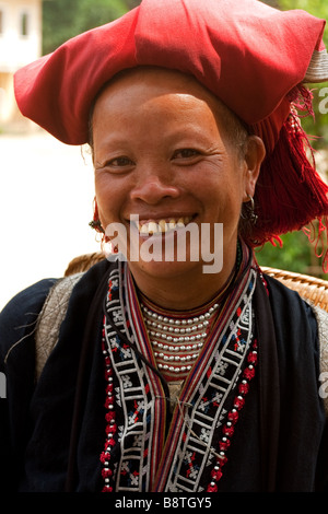 Colourful Dao mountain lady of northern Vietnam - Stock Photo