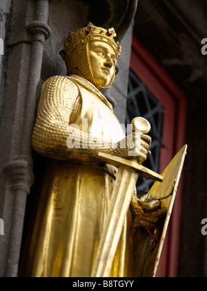 Golden knight on facade of the Basilica of the holy blood church in the historic city center of Bruges Brugge Belgium - Stock Photo