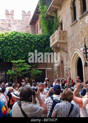 Juliet's balcony in Verona, Italy, of the Romeo and Juliet tragedy, with many tourists looking. - Stock Photo