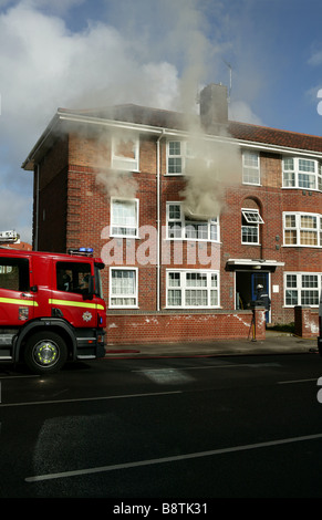 Fire crews in attendance of a house fire - Stock Photo