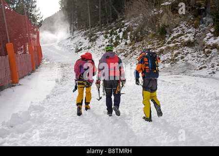 Three mountaineers leave from the ski resort of Vallter 2000 to the mountain Ripolles Girona Province Catalonia - Stock Photo
