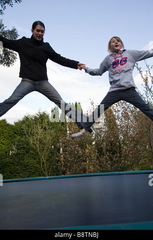 trampolines for teenagers teenagers playing on a garden trampoline seen from below stock