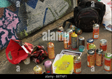 Spray paint cans used in painting graffiti and wall murals - Stock Photo