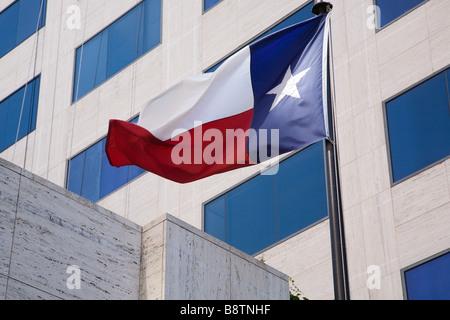 The Texas Flag waving backwards in Austin, Texas - Stock Photo