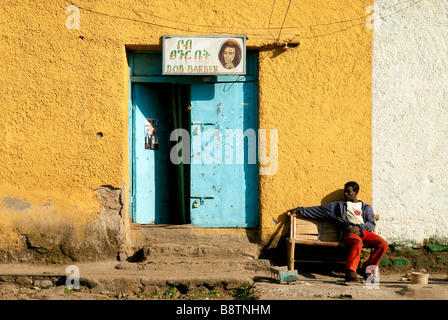 gonder ethiopia east africa man relaxing barber shop - Stock Photo