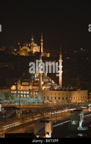 New Mosque Yeni Cami with Galata Bridge in Front and Nuru Osmaniye Mosque in Background Istanbul Turkey - Stock Photo