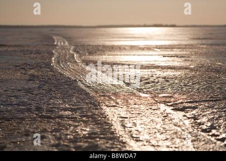 Frozen snowmobile track on sea ice , Finland - Stock Photo
