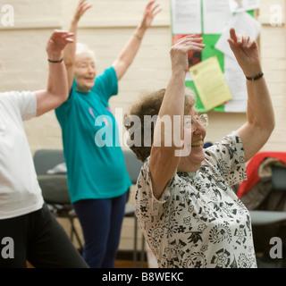 Elderly women at a keep fit class. - Stock Photo