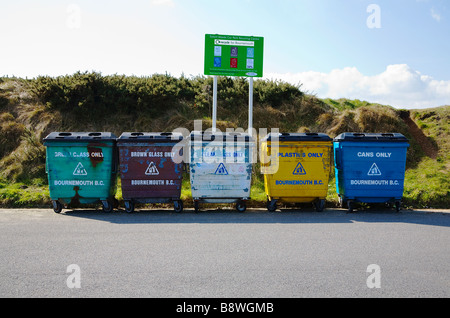 Bournemouth Council, Solent Meads Recycling Centre. Bournemouth, Dorset. UK. Row of five bins for glass, plastic - Stock Photo