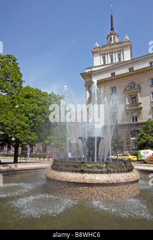 Parliament Building annex and fountain in the square in front of the president's offices in Sofia - Stock Photo