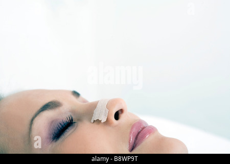 woman with plaster to breathe - Stock Photo