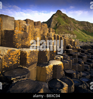 Hexagonal shaped rocks of Giant s Causeway with light reflecting on the different levels of rocks - Stock Photo
