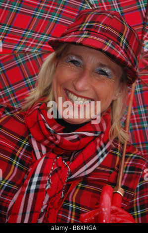 head and shoulders portrait of smiling lady at Maastricht Carnival Netherlands - Stock Photo