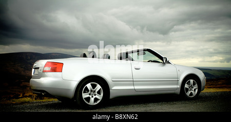 Convertible Audi A4 1.8T in silver with roof folded - Stock Photo