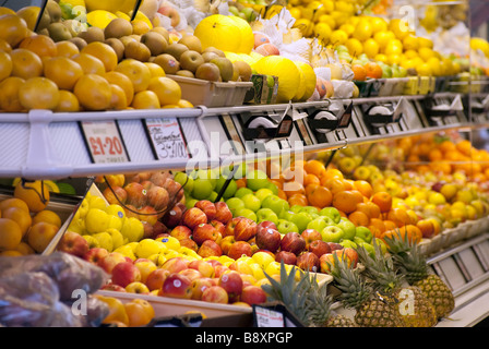 A selection of fruit inside a greengrocer's shop - Stock Photo