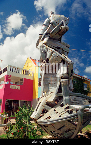 A sculpture in the back garden of well known Curacao artist Yuri Kirindongo made of recycled pieces of chrome from - Stock Photo