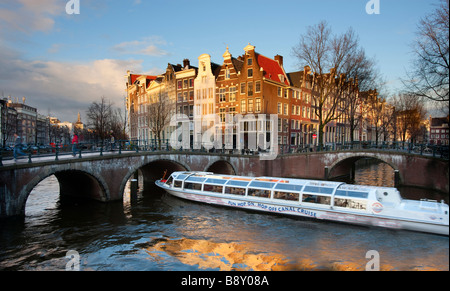 Tourist boat on Prinsengracht canal Amsterdam Holland - Stock Photo