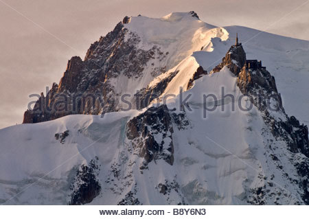 Mont Blanc de Tacul and Aiguille du Midi north faces at dawn, Chamonix, France - Stock Photo