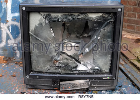 Amsterdam The Netherlands Television with its screen smashed in dumped on the street. - Stock Photo