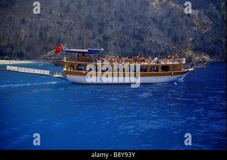 turist turkish boat at butterfly valley (Kelebek Vadisi) in oludeniz, turkey - Stock Photo