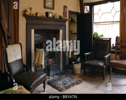 ... The front parlour of the 1930s house at the Birmingham Back to Backs  with a rug