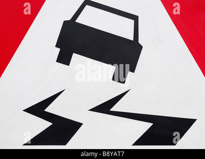 Slippery Road Sign - Stock Photo