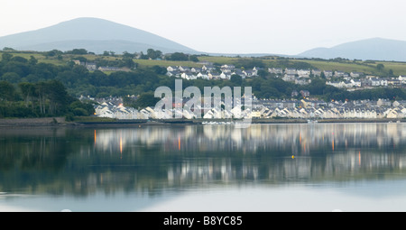 A view from Plas Newydd on Anglesey Wales at sunrise looking towards the Menai Strait and Snowdonia - Stock Photo