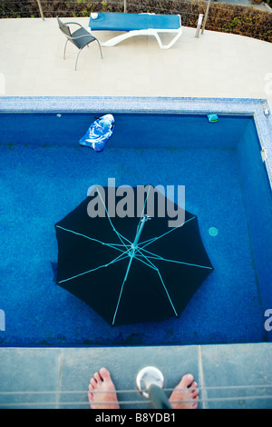 A parasol in a swimming-pool Spain. - Stock Photo