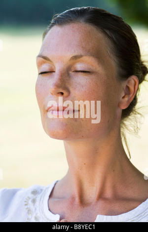 A woman practising yoga Sweden. - Stock Photo