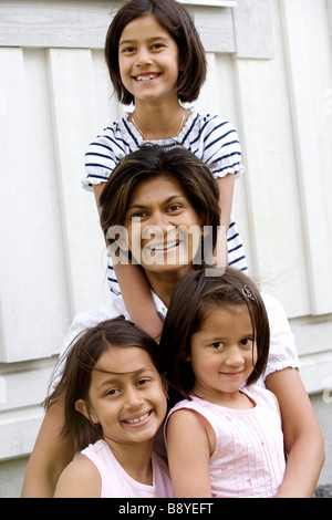 A mother with three daughters. - Stock Photo