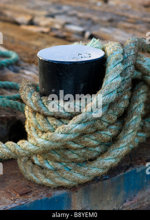 Bollard and rope Sweden. - Stock Photo