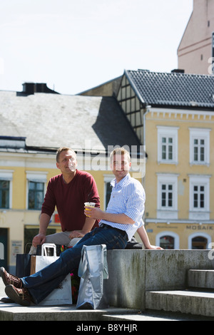 Two men as tourists in Malmo Sweden. - Stock Photo