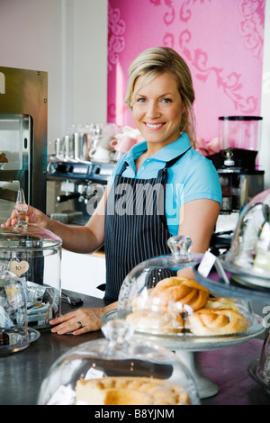 A woman working at a café Sweden. - Stock Photo
