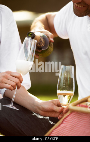 Couple having champagne Copenhagen Denmark. - Stock Photo