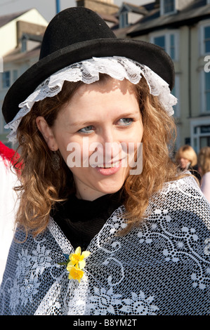 March 1st St Davids day a young woman in Welsh National Costume Wales UK - wearing a traditional lace trimmed tall - Stock Photo