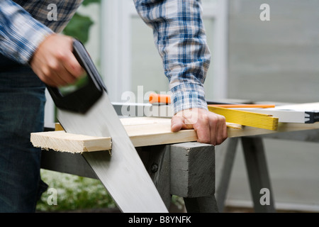 A man using a saw Sweden. - Stock Photo