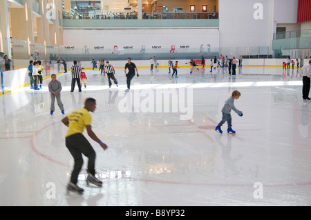 skaters on ice rink in shopping mall, dubai, uae - Stock Photo