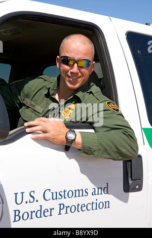 United States Border Patrol agent at the U S Mexico border along the All American Canal near Calexico California - Stock Photo