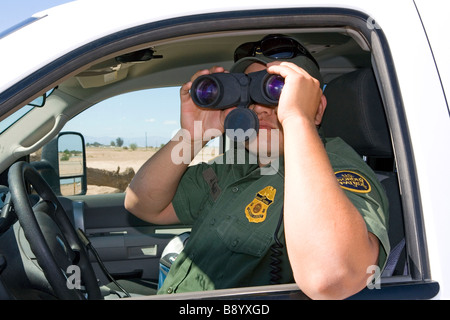 U S Border Patrol agent at the U S Mexico border along the All American Canal near Calexico California - Stock Photo