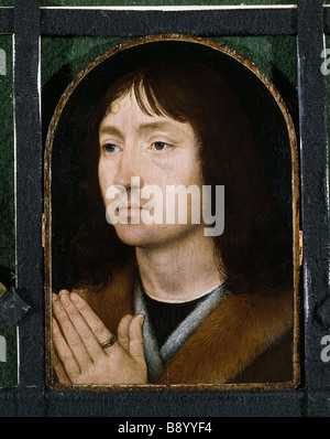 AN UNKNOWN MAN or Portrait of a Praying Man, by Hans Memling (c.1430/40 - 94), at Upton House, post-conservation. - Stock Photo
