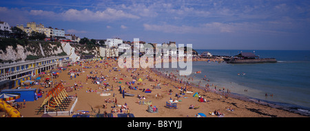 Panoramic landscape view of a crowded Viking Bay Beach on a sunny summers day Broadstairs.Thanet. Kent. SE England. - Stock Photo