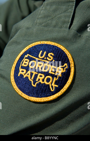 United States Border Patrol patch on an agent at the U S Mexico border along the All American Canal near Calexico - Stock Photo